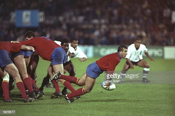 Daniel Neaga of Romania passes the ball to his backs during the Rugby World Cup match against Fiji in Brive France Romania won the match 1715...
