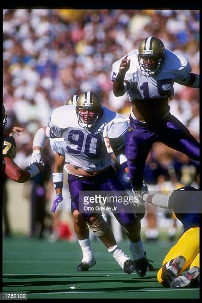 Defensive tackle Steve Emtman of the Washington Huskies tries to break through the line during a game against the California Bears at Memorial...