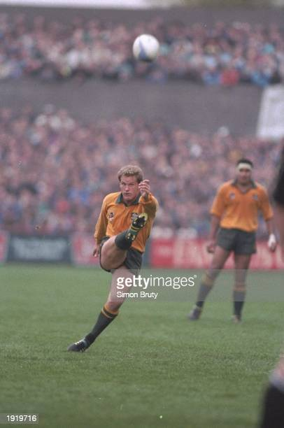 Michael Lynagh of Australia kicks the ball forward during the World Cup semi-final against New Zealand at Lansdowne Road in Dublin, Ireland....