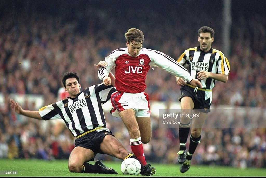 Paul Merson of Arsenal breaks through the Notts County defence during a Barclays League Division One match at Highbury in London. Arsenal won the match 2-0. \ Mandatory Credit: Chris Cole/Allsport