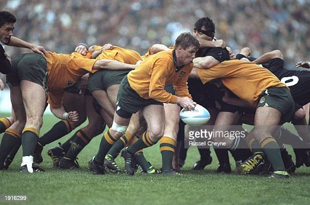 Scrum Half Nick FarrJones of Australia passes the ball away from the scrum in the Australia v New Zealand semi finals match during the 1991 Rugby...