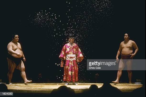Two contestants participate in the salt throwing ceremony before the contest commences in the Grand Sumo Tournament at the Royal Albert Hall London...