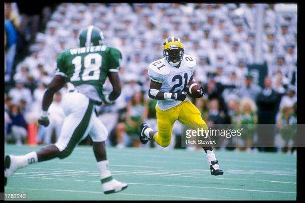 Wide receiver Desmond Howard of the Michigan Wolverines runs with the football during a game against the Michigan State Spartans Michigan won the...