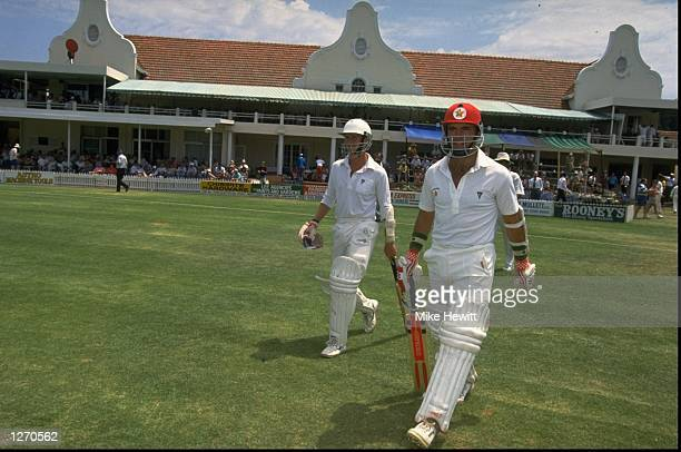 Andy Flower and Kevin Arnott of Zimbabwe walk out to start the First Test match against India at Harare Sports Club in Zimbabwe The match ended in a...
