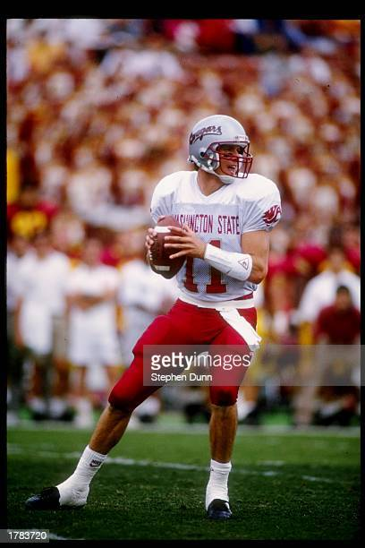 Quarterback Drew Bledsoe of the Washington State Cougars prepares to pass the ball during a game against the USC Trojans USC won the game 3121