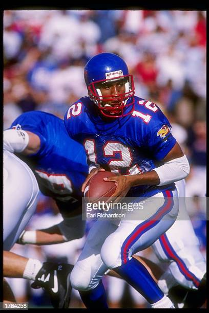 Quarterback Frederick Thomas of the Kansas Jayhawks drops back during a game against the Kansas State Wildcats at Memorial Stadium in Lawrence Kansas...