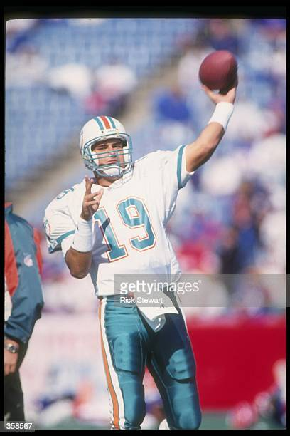 Quarterback Scott Mitchell of the Miami Dolphins throws the ball during a game against the Buffalo Bills at Rich Stadium in Orchard Park New York The...