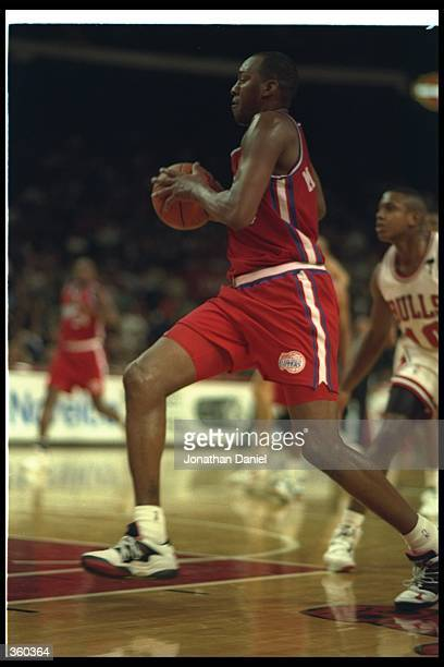 Danny Manning of the Los Angeles Clippers moves the ball during a game against the Chicago Bulls at Chicago Stadium in Chicago Illinois Mandatory...