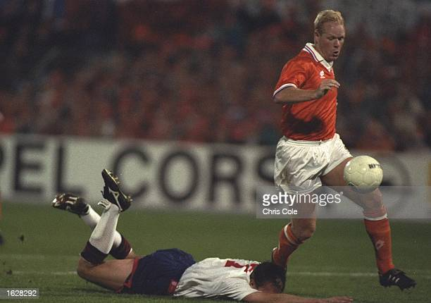 David Platt of England is fouled by Ronald Koeman of Holland during the World Cup Qualifyingr match in Rotterdam Netherlands Holland won the match 20...