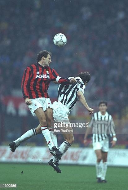 Franco Baresi of AC Milan and Andreas Moller of Juventus jump for the ball during a Serie A match at the San Siro Stadium in Milan Italy The match...