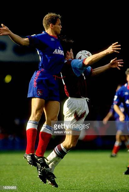Jakob Kjeldbjerg of Chelsea jumps for the ball with Trevor Morley of West Ham United during an FA Carling Premiership match at Upton Park in London...