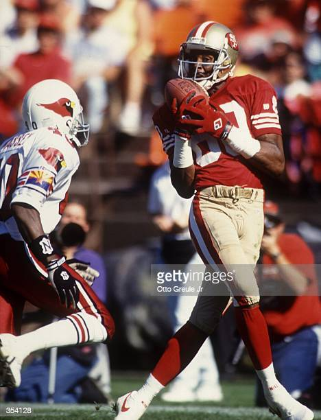 Jerry Rice of the San Fransisco 49ers makes a reception during their game against the Phoenix Cardinals The 49ers won 2814