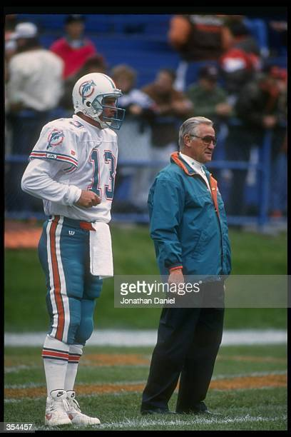 Miami Dolphins quarterback Dan Marino and head coach Don Shula look on during a game against the Cleveland Browns at Cleveland Stadium in Cleveland...