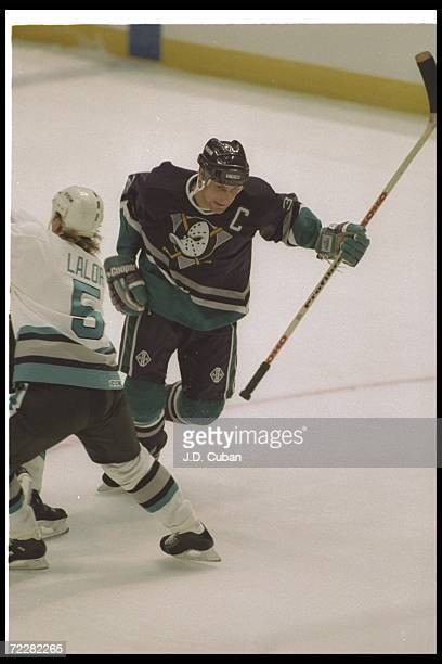 Stu Grimson of the Anaheim Mighty Ducks bench moves down the ice during a preseason game against the San Jose Sharks at Arrowhead Pond in Anaheim...