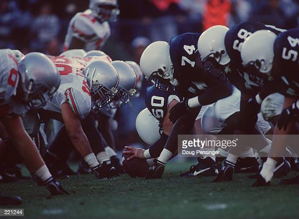 General view of the line of scrimmage as the offensive line of the Penn State Nittany Lions sets their feet in preparation to block the defensive...