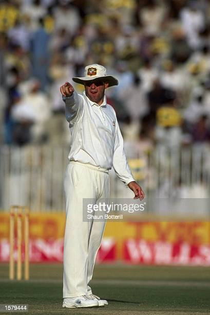 Captain Mark Taylor of Australia adjusts his fielders during the tour of Pakistan
