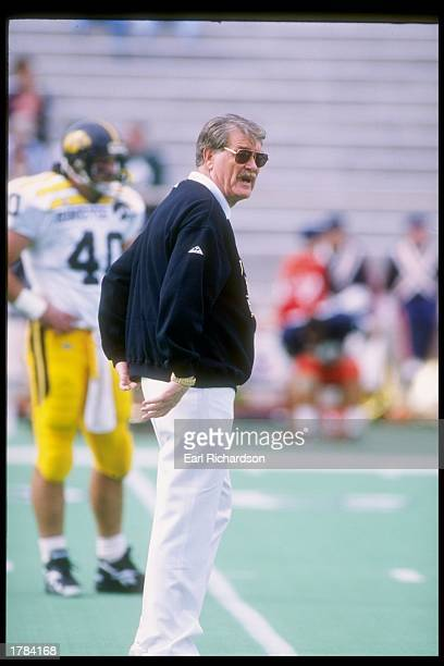 Coach Hayden Fry of the Iowa Hawkeyes looks on during a game against the Illinois Fighting Illini The Illinois Fighting Illini won the game 477