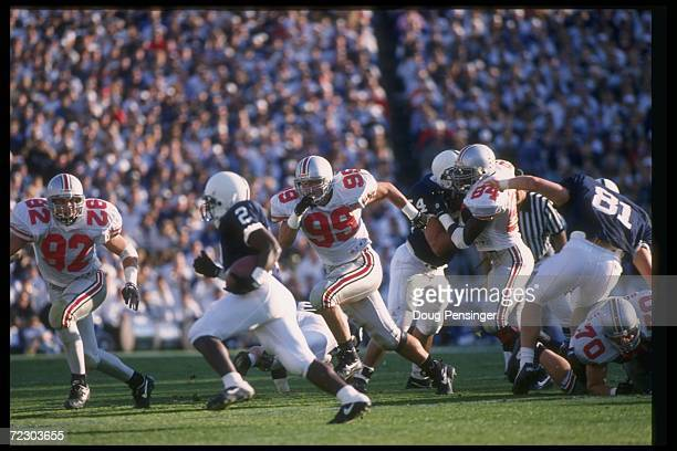 Defensive lineman Luke Fickell of the Ohio State Buckeyes pursues a Penn State Nittany Lions player during a game at Beaver Stadium in University...