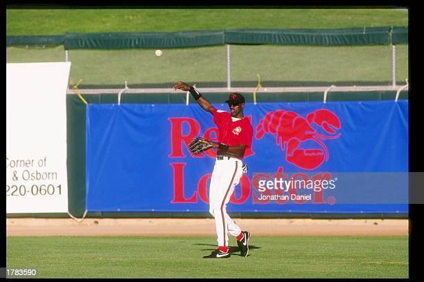 Michael Jordan of the Scottsdale Scorpions throws the ball during an Arizona Fall League game.
