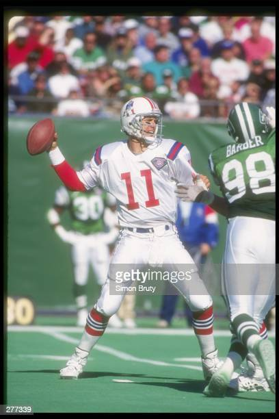 Quarterback Drew Bledsoe of the New England Patriots looks to pass the ball during a game against the New York Jets at Giants Stadium in East...