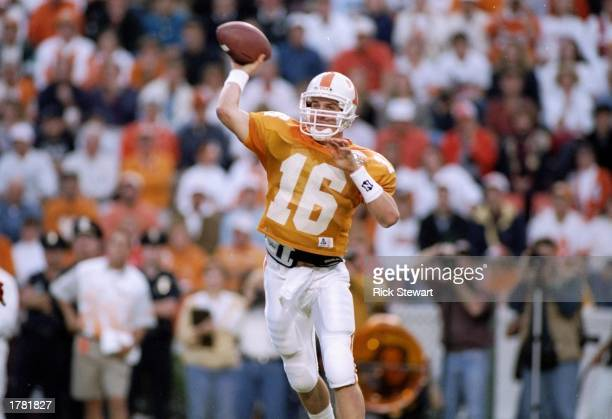 Quarterback Peyton Manning of the Tennessee Volunteers in action during a game against the Alabama Crimson Tide The Alabama Crimson Tide won the game...