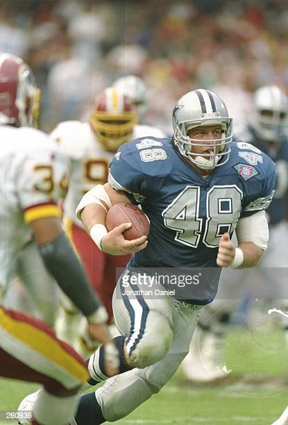 Running back Daryl Johnston of the Dallas Cowboys moves the ball during a game against the Washington Redskins at RFK Stadium in Washington D C The...