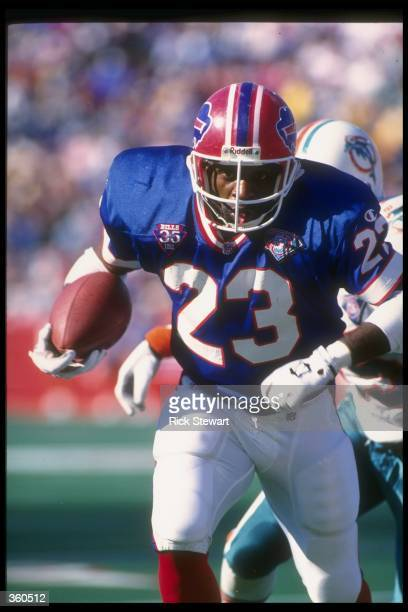 Running back Kenneth Davis of the Buffalo Bills runs with the ball during a game against the Miami Dolphins at Rich Stadium in Orchard Park, New...