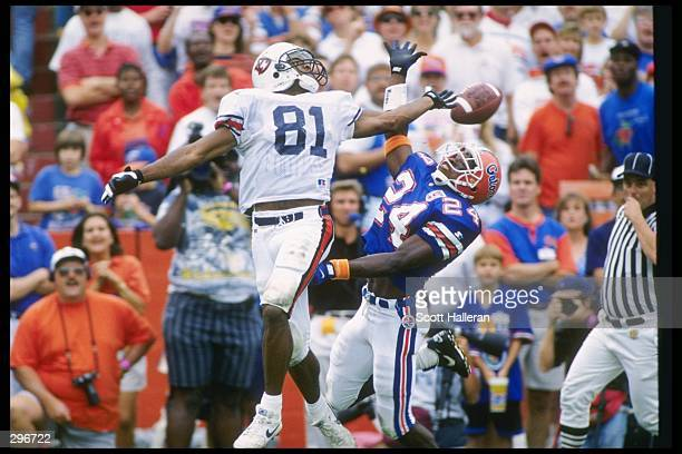 Wide receiver Frank Sanders of the Auburn Tigers and defensive back Dell McGee of the Florida Gators jump for the ball during a game at Florida Field...