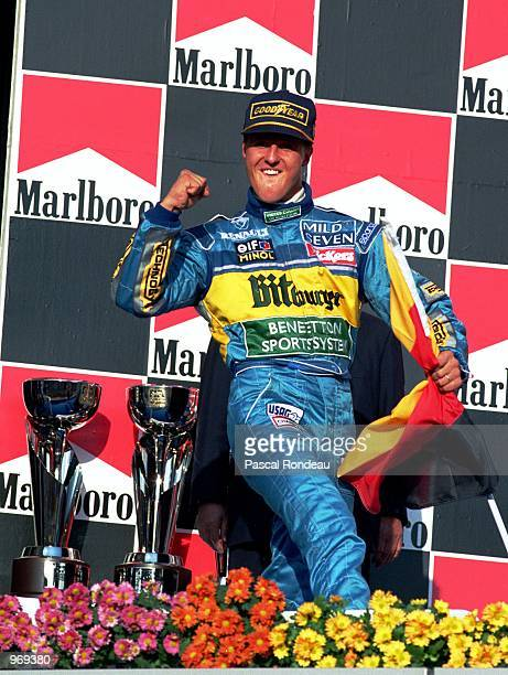 Benetton driver Michael Schumacher of Germany celebrates on the podium after winning the Pacific Formula One Grand Prix held at the T1 Circuit in...