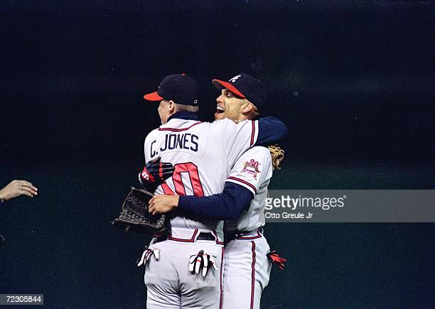 David Justice of the Cleveland Indians is congratulated by Chipper Jones after catching the game ending fly ball to win game four of the World Series...