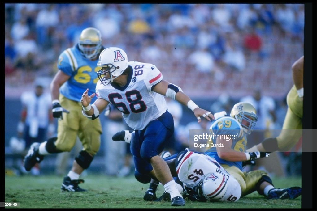 Defensive end Tedy Bruschi of the Arizona Wildcats penetrates the offensive line during a game against the California at Los Angeles Bruins at the Rose Bowl in Pasadena, California. California at Los Angeles won the game 17-10. Mandatory Cr