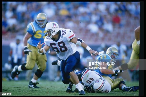 Defensive end Tedy Bruschi of the Arizona Wildcats penetrates the offensive line during a game against the California at Los Angeles Bruins at the...