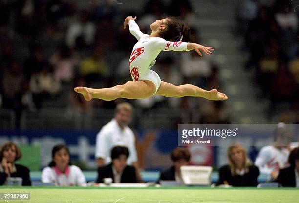 Dominique Moceanu of the USA in is in action during the Women's Floor competition in the World Gymnastics Championships in Sabae Japan Mandatory...