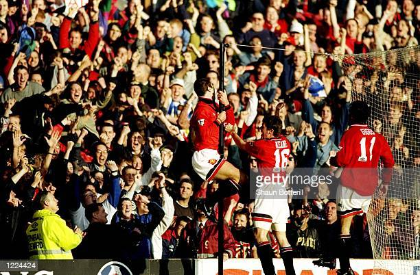 Eric Cantona of Manchester United celebrates during an FA Carling Premiership match against Liverpool at Old Trafford in Manchester England The match...