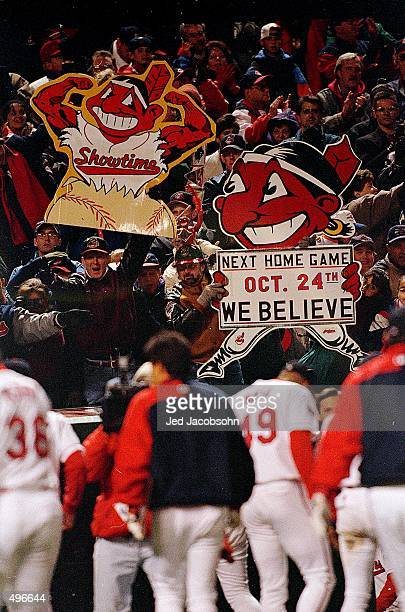 Fans of the Cleveland Indians hold up signs and cheer during the game against the Seattle Mariners at Jacobs Field in Cleveland, Ohio. The Indians...