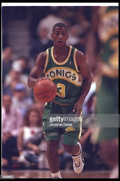 Guard Eric Snow of the Seattle SuperSonics moves the ball during a game against the Chicago Bulls at the United Center in Chicago Illinois The Bulls...