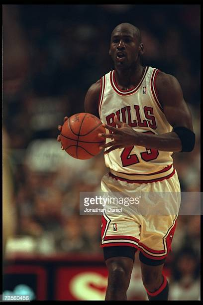 Guard Michael Jordan of the Chicago Bulls trots down court and passes against the Seattle Supersonics at the United Center in Chicago Illinois The...