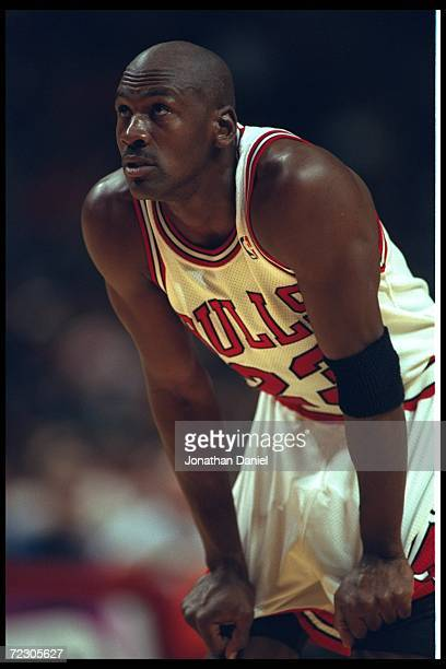 Guard Michael Jordan of the Chicago Bulls watches a free throw attempt at the United Center in Chicago, Illinois, during the game against the Seattle...