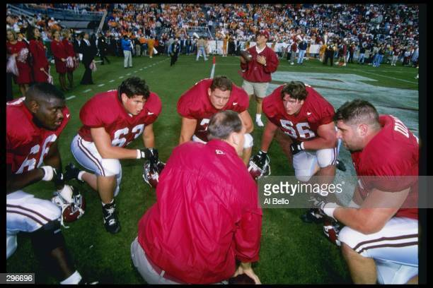 Members of the Alabama Crimson Tide sits in the pregame huddle against the Tennessee Volunteers at Legion Field in Birmingham Alabama Tennessee won...