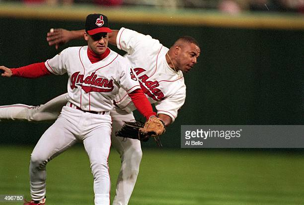 Omar Vizquel of the Cleveland Indians catches the ball with Albert Belle during a game against the Atlanta Braves at the Jacobs Field in Cleveland...