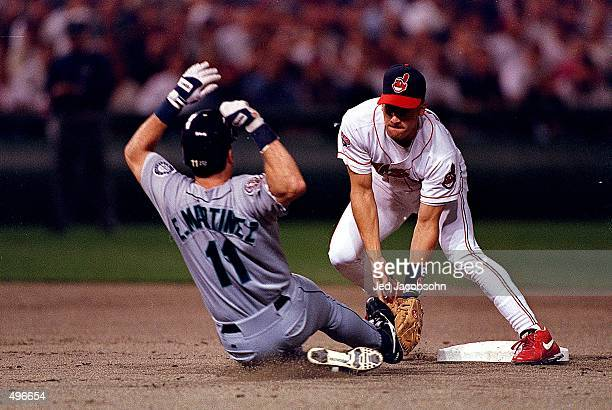 Omar Vizquel of the Cleveland Indians moves to tag Edgar Martinez of the Seattle Mariners as he slides into second base during the ALCS game at...