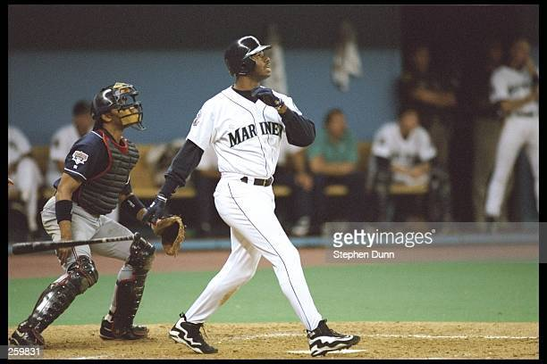 Oufielder Ken Griffey Jr. Of the Seattle Mariners watches his shot during a game playoff game against the Cleveland Indians at the Kingdome in...