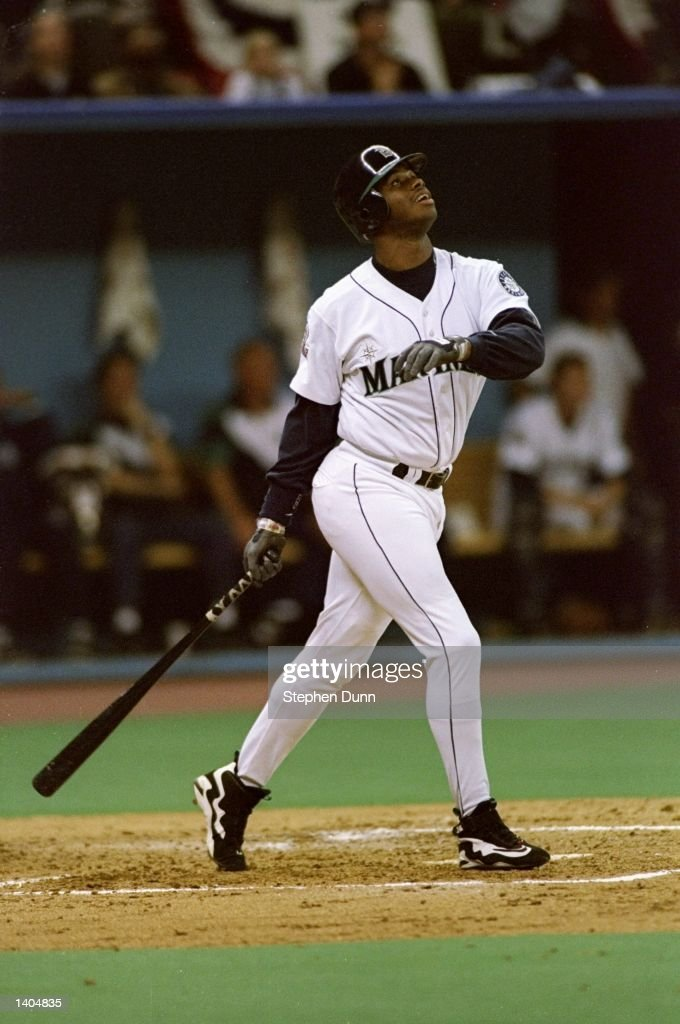 Outfielder Ken Griffey Jr. of the Seattle Mariners stands at the plate looking up during a game against the New York Yankees at the Kingdome in Seattle, Washington. The Mariners won the game 11-8. Mandatory Credit: Stephen Dunn /Allsport