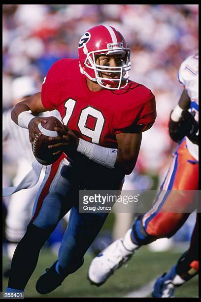 Quarterback Hines Ward of the Georgia Bulldogs drops back to pass during a game against the Florida Gators at Sanford Stadium in Athens, Georiga....