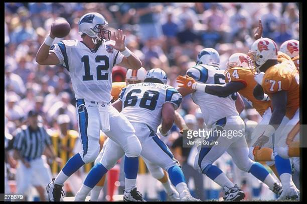 Quarterback Kerry Collins of the Carolina Panthers passes the ball from the pocket during a game against the Tampa Bay Buccaneers at Clemson Memorial...
