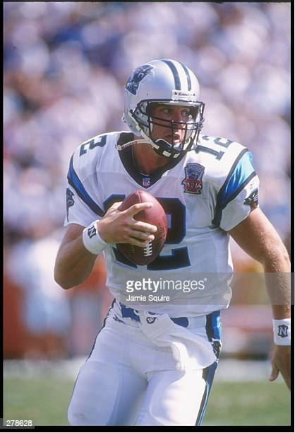 Quarterback Kerry Collins of the Carolina Panthers scrambles with the ball during a game against the Tampa Bay Buccaneers at Clemson Memorial Stadium...