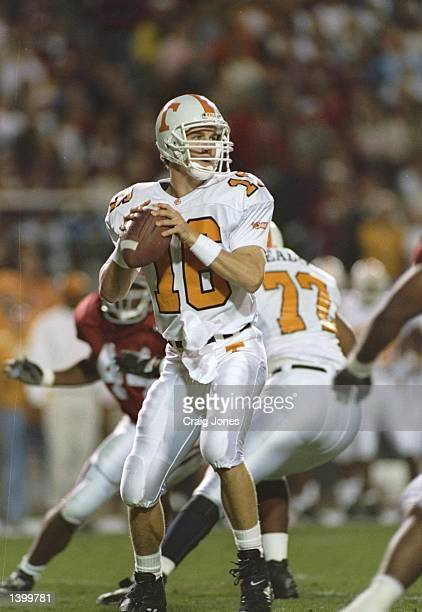 Quarterback Peyton Manning of the Tennessee Volunteers prepares to pass the ball during a game against the Alabama Crimson Tide at Legion Field in...