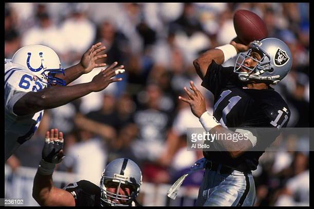 Quarterback Vince Evans of the Los Angeles Raiders throws a pass over Colt defender Ellis Johnson during the Raiders 3017 win over the Colts at...