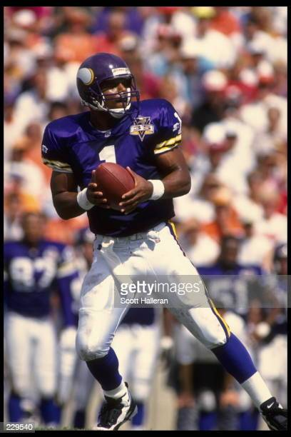 Quarterback Warren Moon of the Minnesota Vikings drops back to pass during the Vikings 2017 loss to the Tampa Bay Buccaneers at Tampa Bay Stadium in...