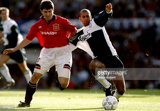Roy Keane of Manchester United takes on Phil Babb of Liverpool during an FA Carling Premiership match at Old Trafford in Manchester England The match...